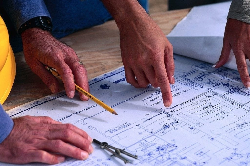 Facility managers reviewing blueprints